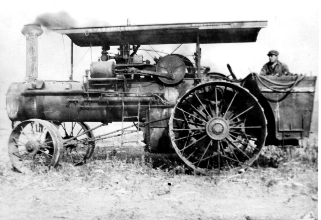 This Baker steam engine was purchased about 1910 by George and Pete Trausch.  Pete is shown in the photo.  Their brother, Matt Trausch, purchased the steam engine in 1924 for $250. Matt's son Bert was the engineer on this machine.