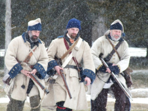 Reinactors wearing winter uniforms of French Canadian soldiers.