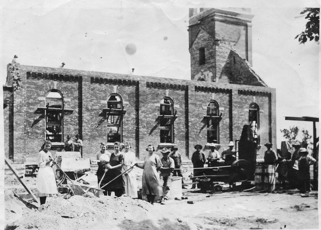 Once it was determined that the walls and bell tower were still structurally sound, reconstruction began with the congregation furnishing much of the labor.  This photo was taken in 1920.