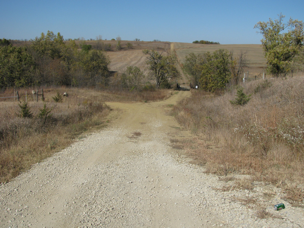 Looking north from the cemetery entrance.  Cemetery is to the right.  Sharp farm is in the distance to the right.