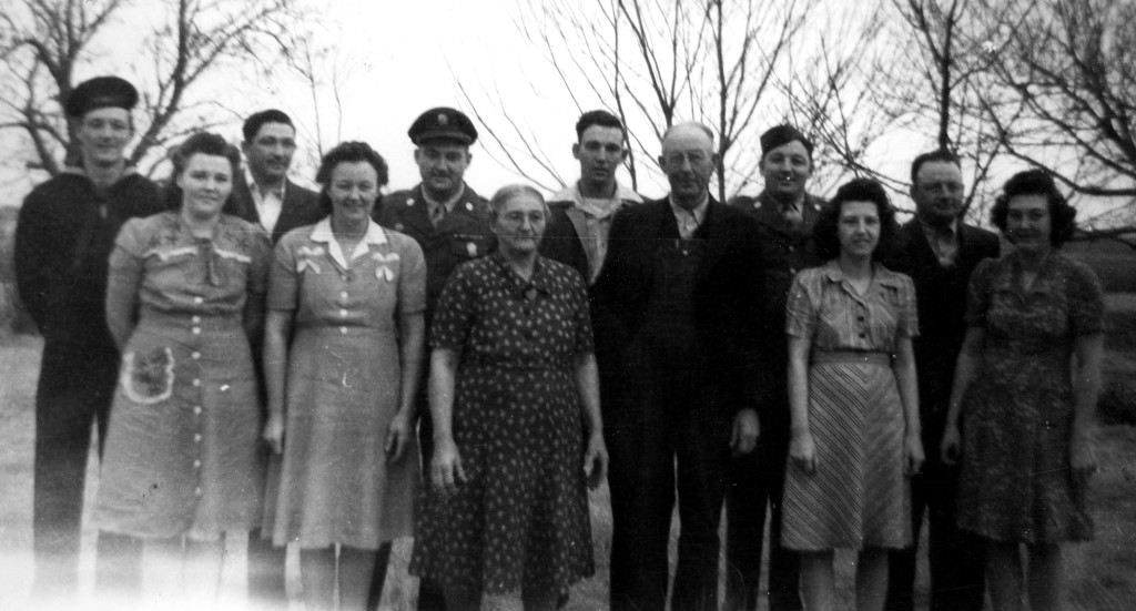 The Matt Trausch family during World War II.  Back left to right: Vern, Elmer, Charles, Bud, Alfred, Bert.   Front: Laurine, Martha, Grsndma, Grandpa, Susan and Jeanette.