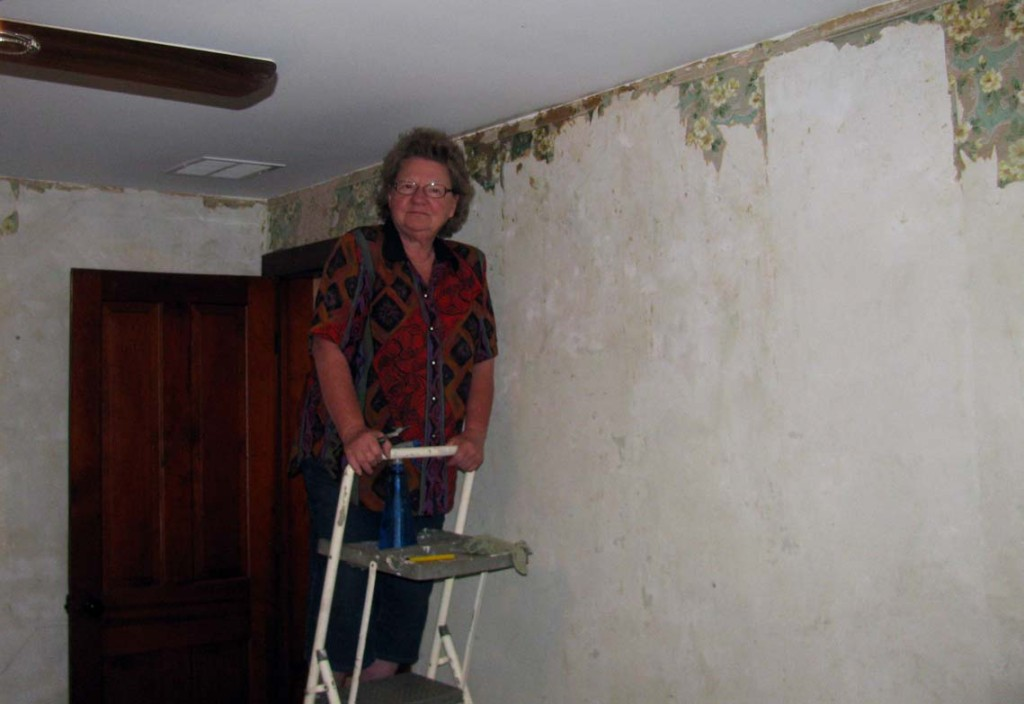 Removing wallpaper in the south upstairs bedroom June 2015.