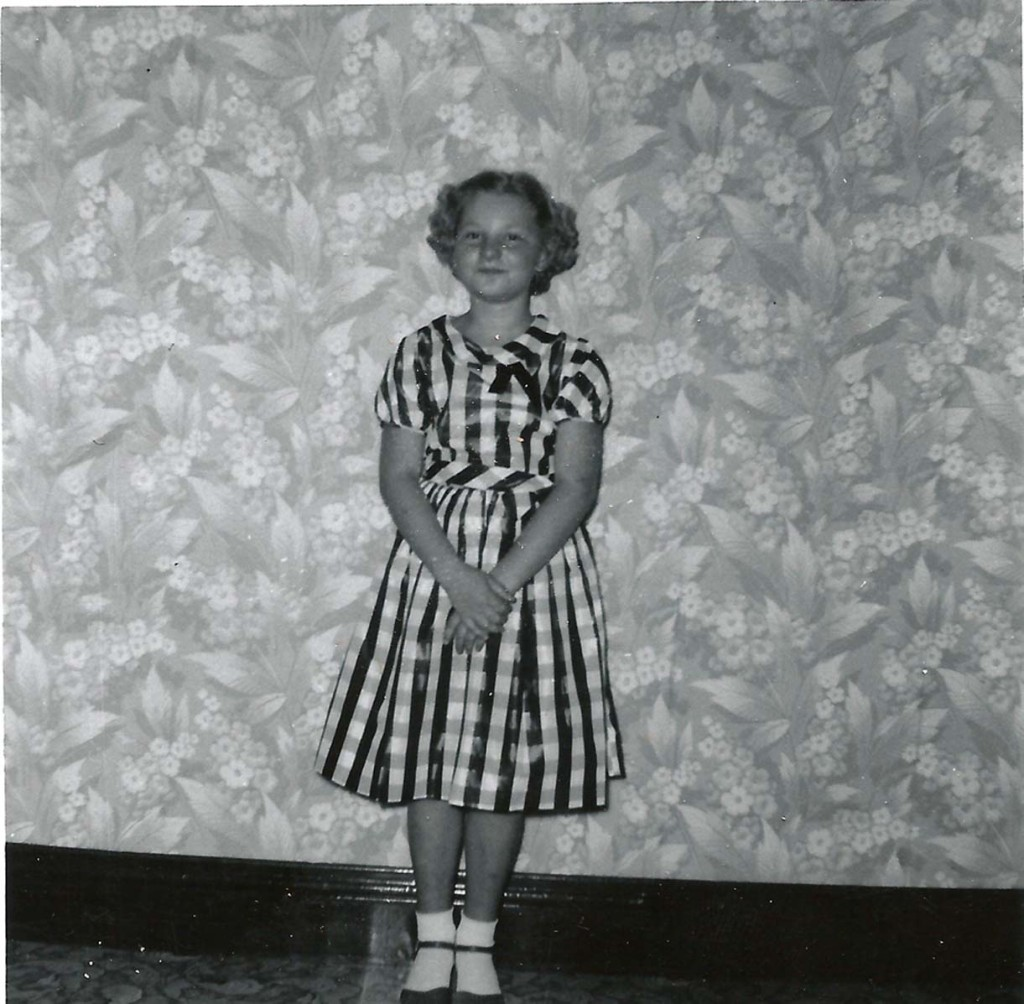 Dining room wallpaper about 1958.  The paper was grey with pink flowers.  I don't remember the occasion, but do remember the dress.  I loved that dress.  It was a hand-me-down from my cousin, Amber Trausch who lived in California and had beautiful store-bought dresses.