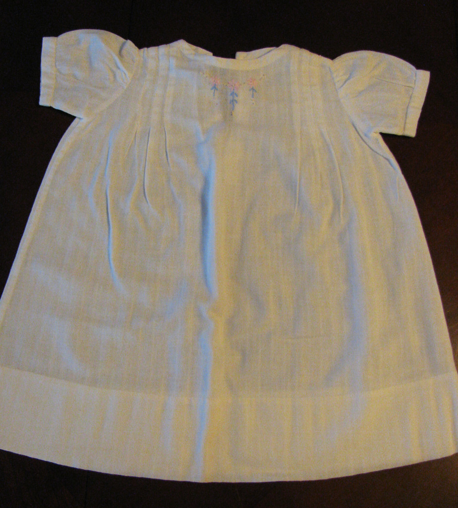 This white baby dress Mom made as part of my layette.