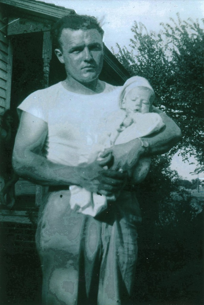Bud Renschler holding Pat.  Pat grew up to look like his Dad.  The photo wasn't dated.