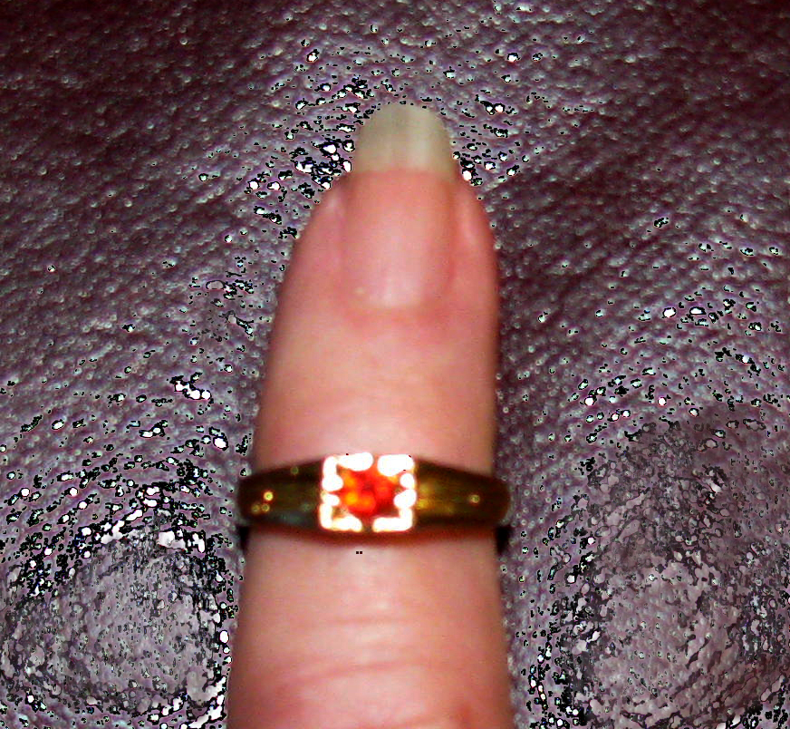 Pat's baby ring.  It was the custom for babies to wear rings which were usually tied on with a ribbon.  The set is a garnet which is Pat's birth stone.